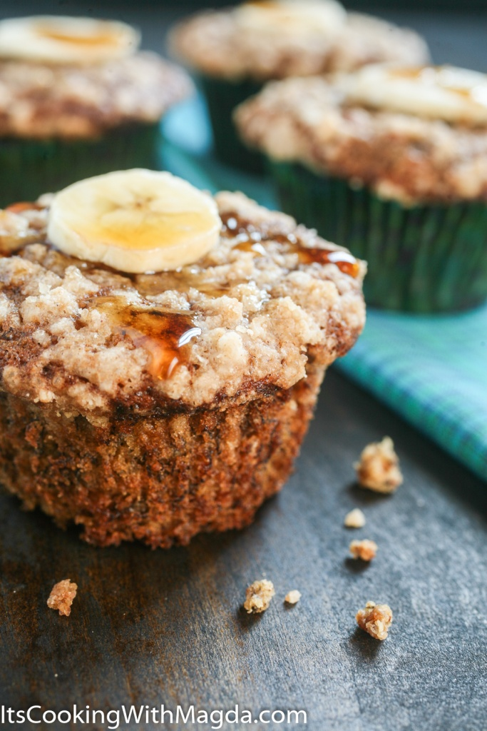 banana muffins with a slice of banana and a drizzle of maple syrup