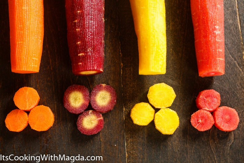 Peeled and partialy sliced rainbow carrots