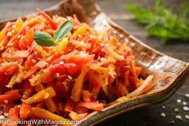 Grated carrots and apple salad on a square plate