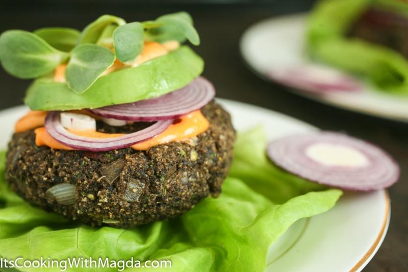 mushroom jalapeno burger with sriracha, avocado, red onion on a lettuce leaf