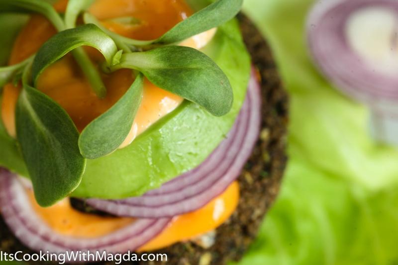 mushroom and jalapeno burger with orange sriracha sauce, red onions