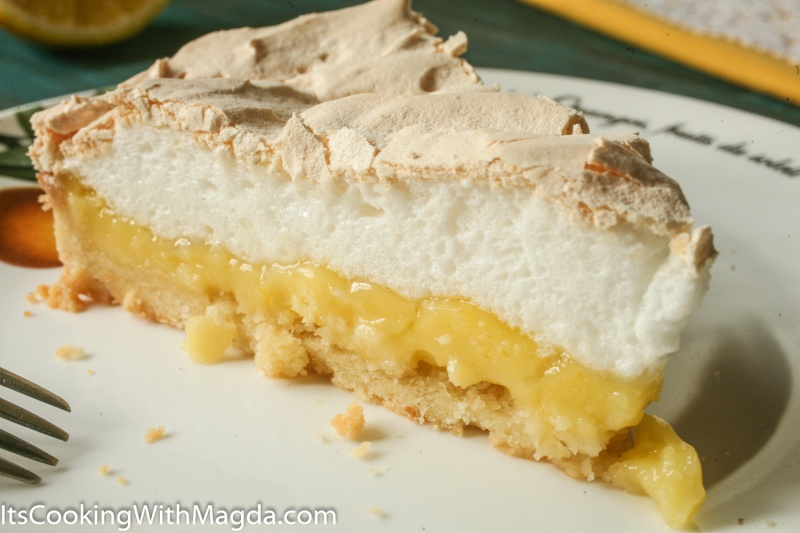 lemon meringue tart slice with a fork