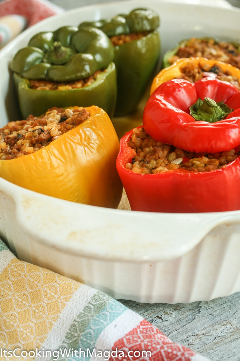 cooked bell peppers stuffed with meat, rice, vegetables