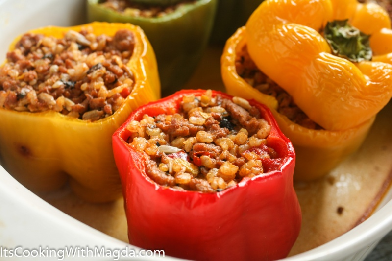 cooked bell peppers stuffed withrice, vegetables and ground turkey