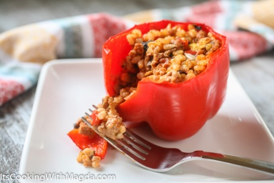 bell peppers stuffed with rice, meat, vegetables