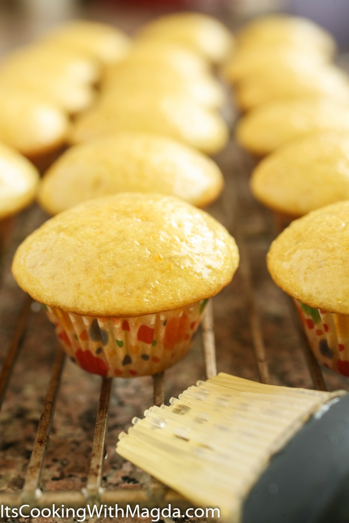 baked cupcakes glazed with lemon syrup