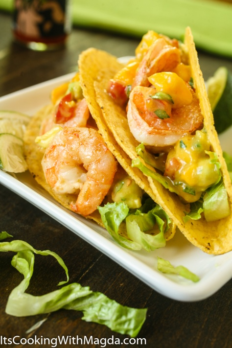 Shrimp tacos with mango avocado salsa on a plate