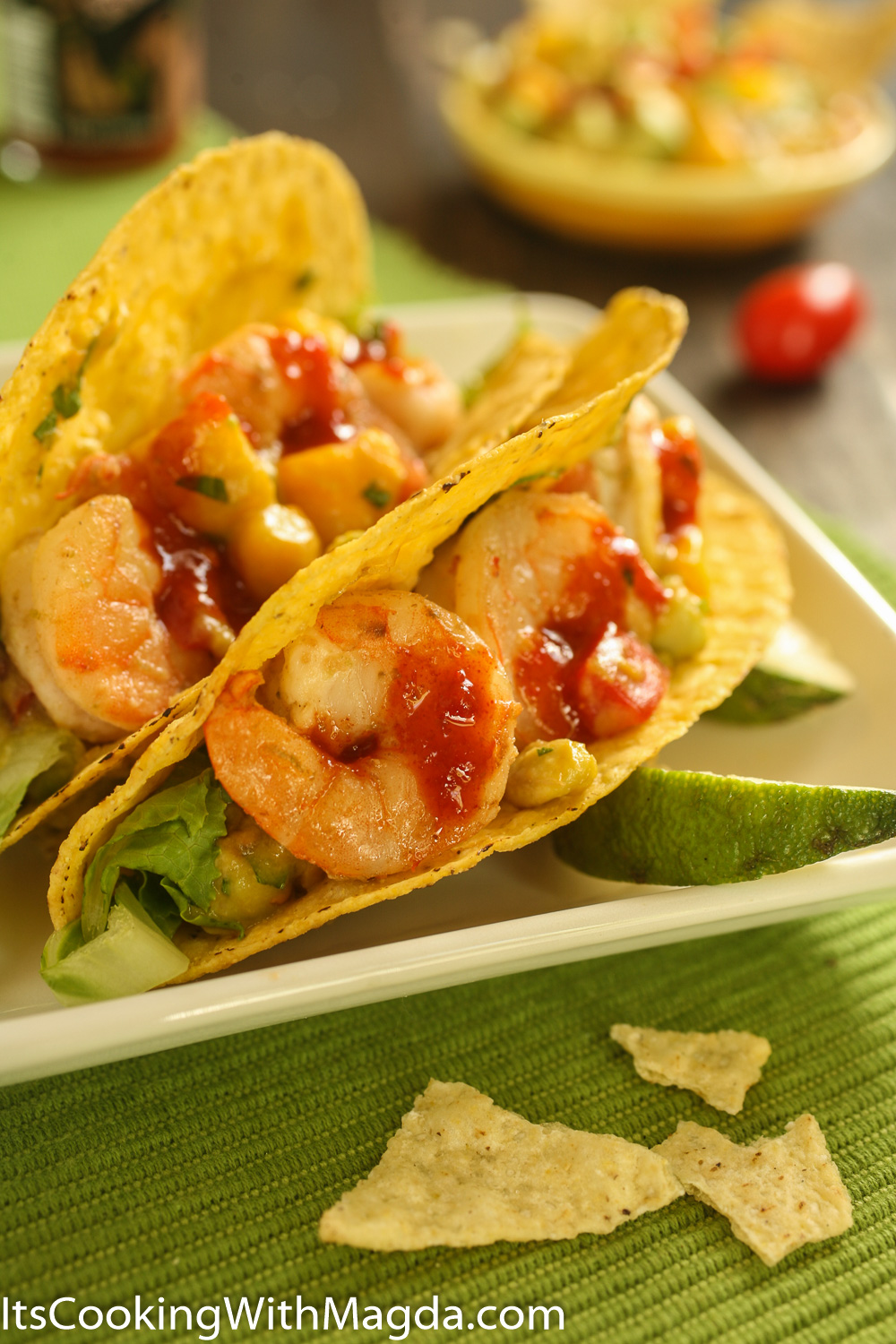 shrimp tacos with mango salsa in a crunchy taco shell with some hot ...