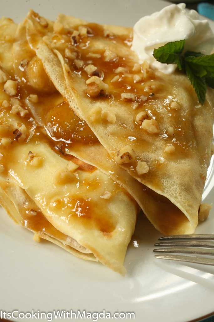 two crepes filled with caramelized bananas and drizzled with banana butter