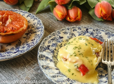 Eggs Benedict with smoked salmon and broiled grapefruit