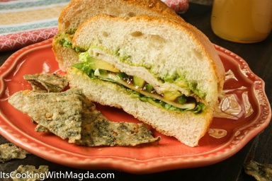 sandwich with turkey, cheese, avocado, jalapeno, fig preserve and lettuce