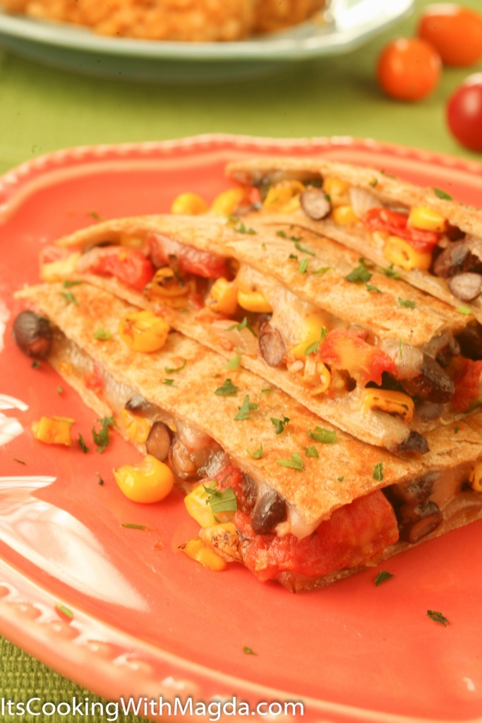 cheese and vegetable quesadilla with a serving of spanish rice