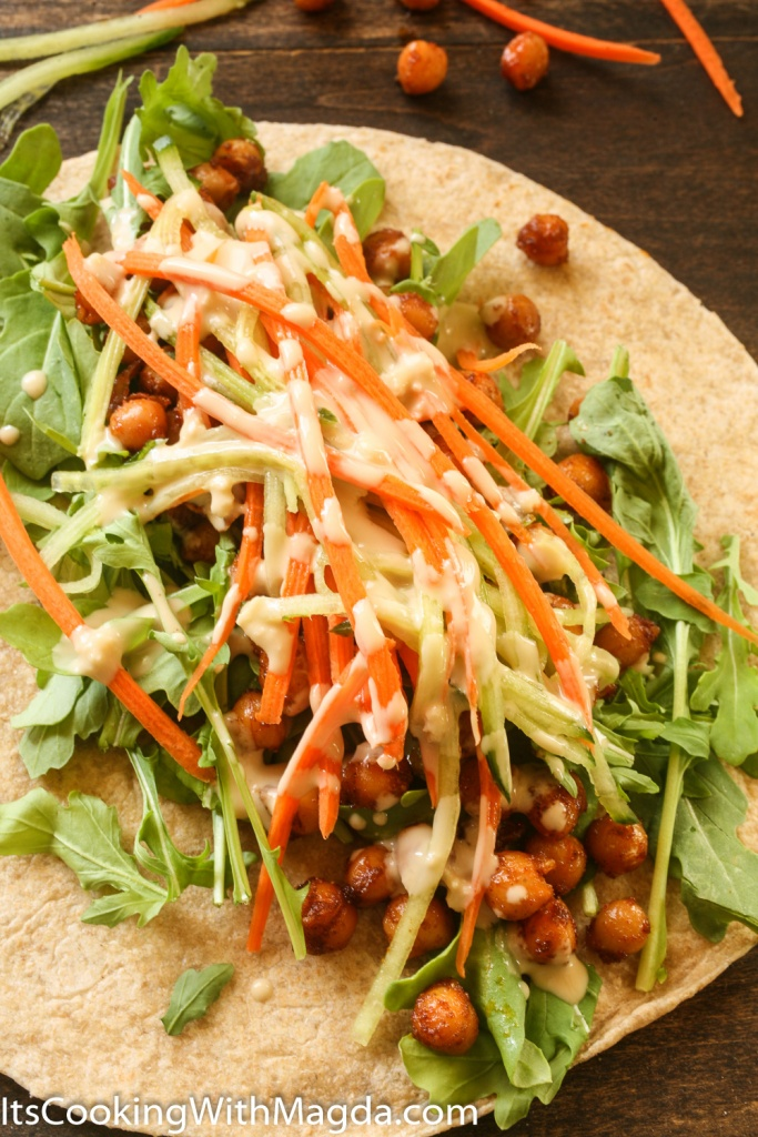 whole wheat wrap with spiced chickpeas, vegetables and tahini dressing