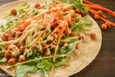 whole wheat wrap with arugula, spiced chickpeas and tahinipeas