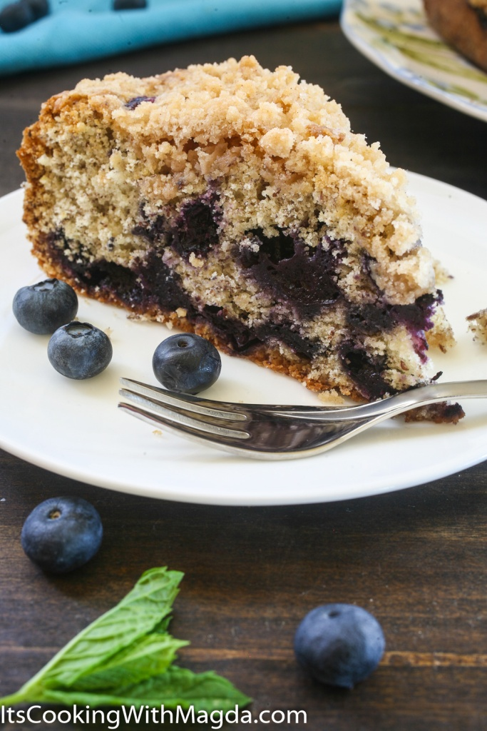a slice of blueberry pie with crumb topping