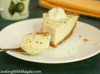 a slice of key lime pie on a white plate