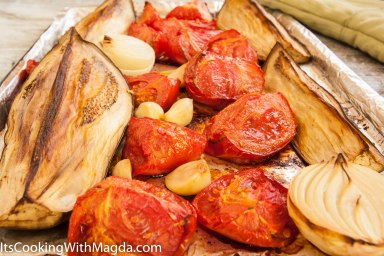 roasted tomatoes and eggplant on a baking pan