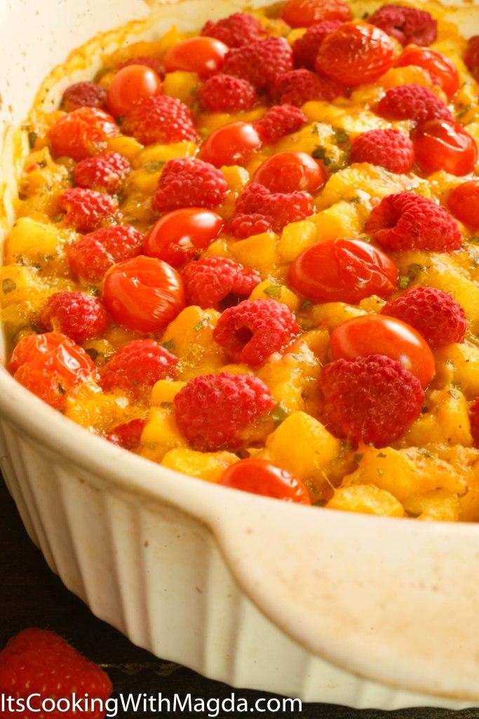 salmon roasted with mango pineapple salsa, raspberries and tomatoes