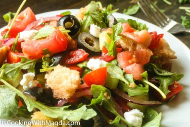 bread salad with tomatoes, olives, greens