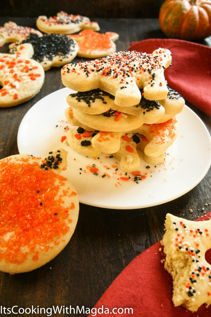 A stack of Halloween cookies decorated with sprinkles