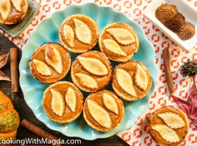 mini pumpkin pies on a blue plate
