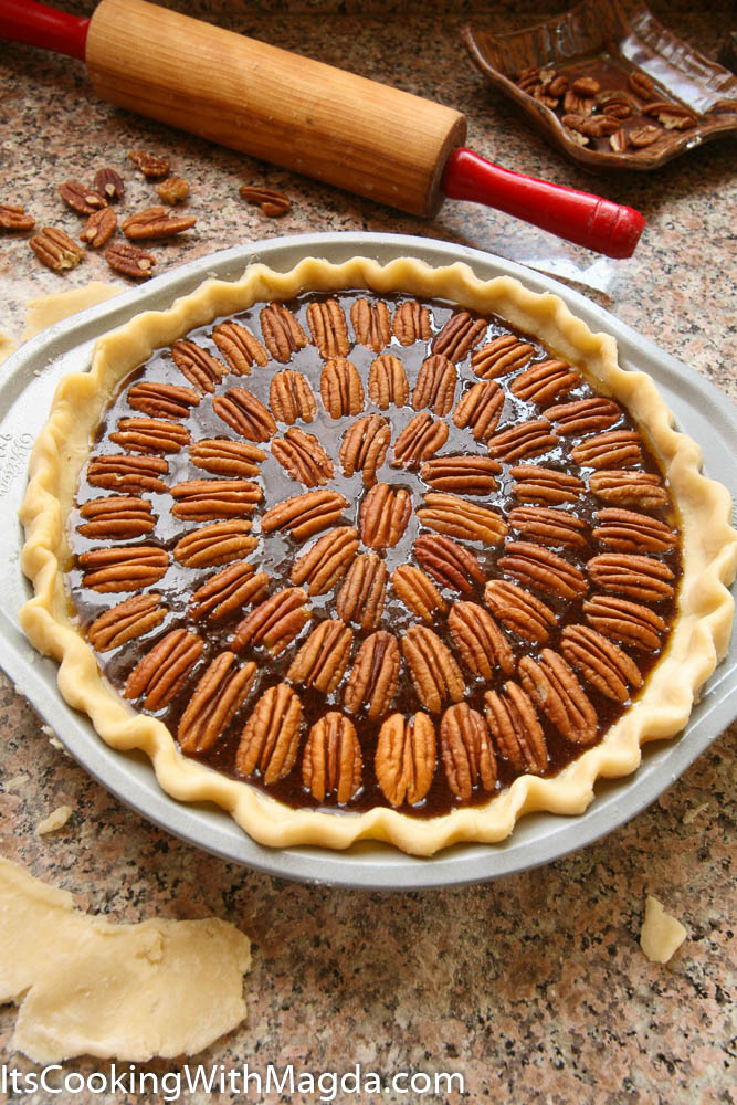 Chocolate Pecan Pie decorated with pecan halves before baking