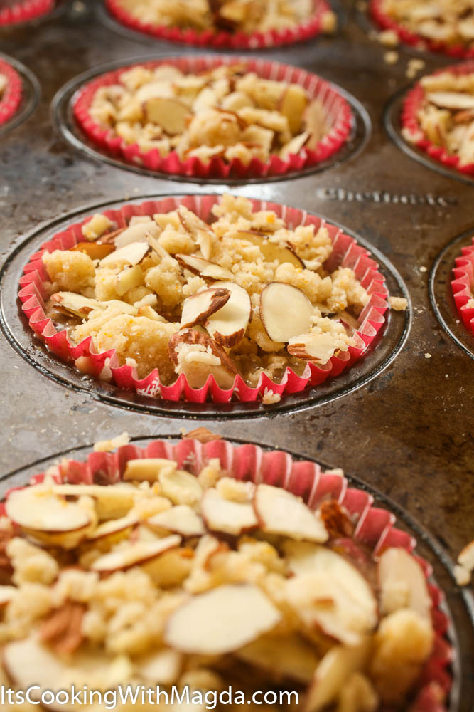 cranberry orange muffins with almond topping before baking