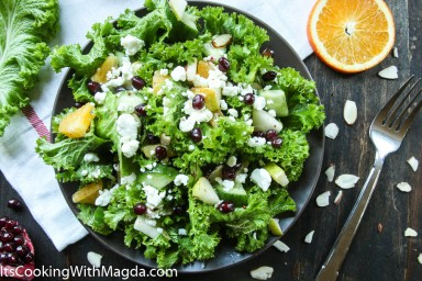 Mustard greens salad with pear, pomegranate and goat cheese