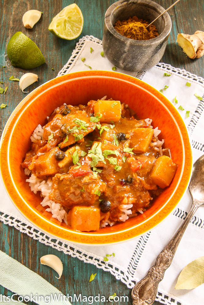 a bowl of rice and chicken curry with pineapple