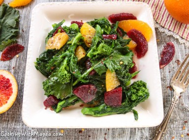 broccoli rabe with orange pieces and spicy red onion dressing