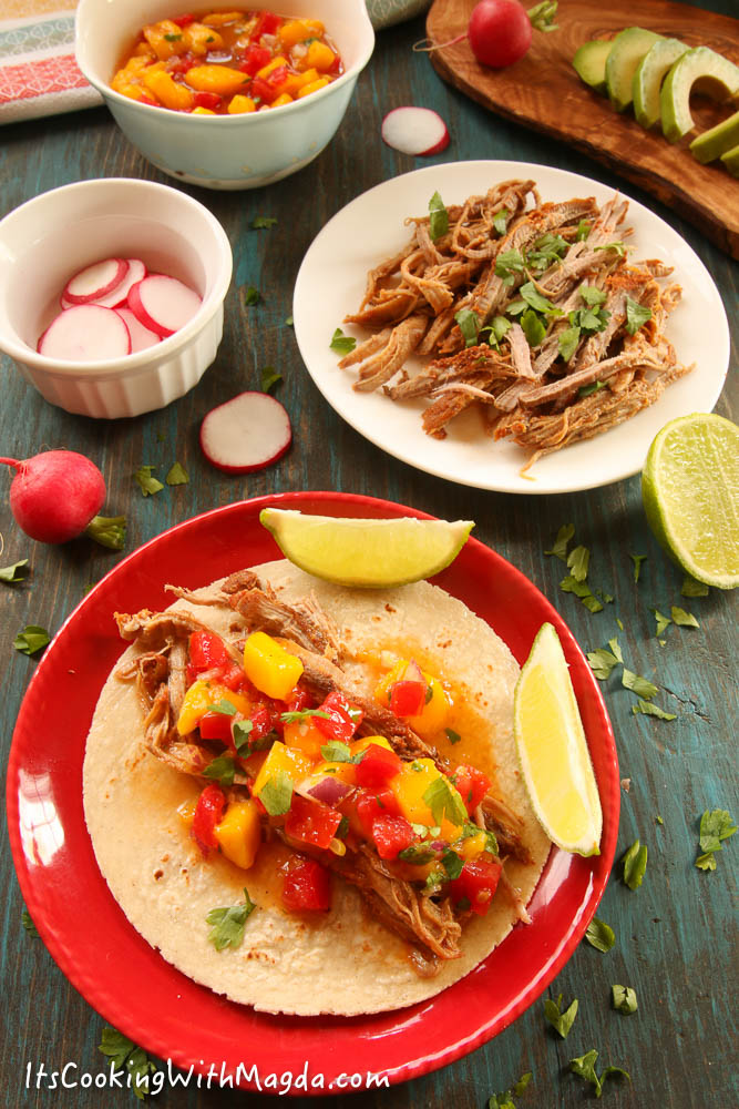 pork taco with mango salsa on a red plate
