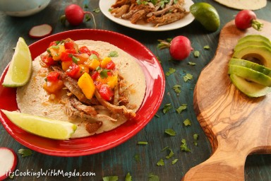 pork taco with mango avocado salsa