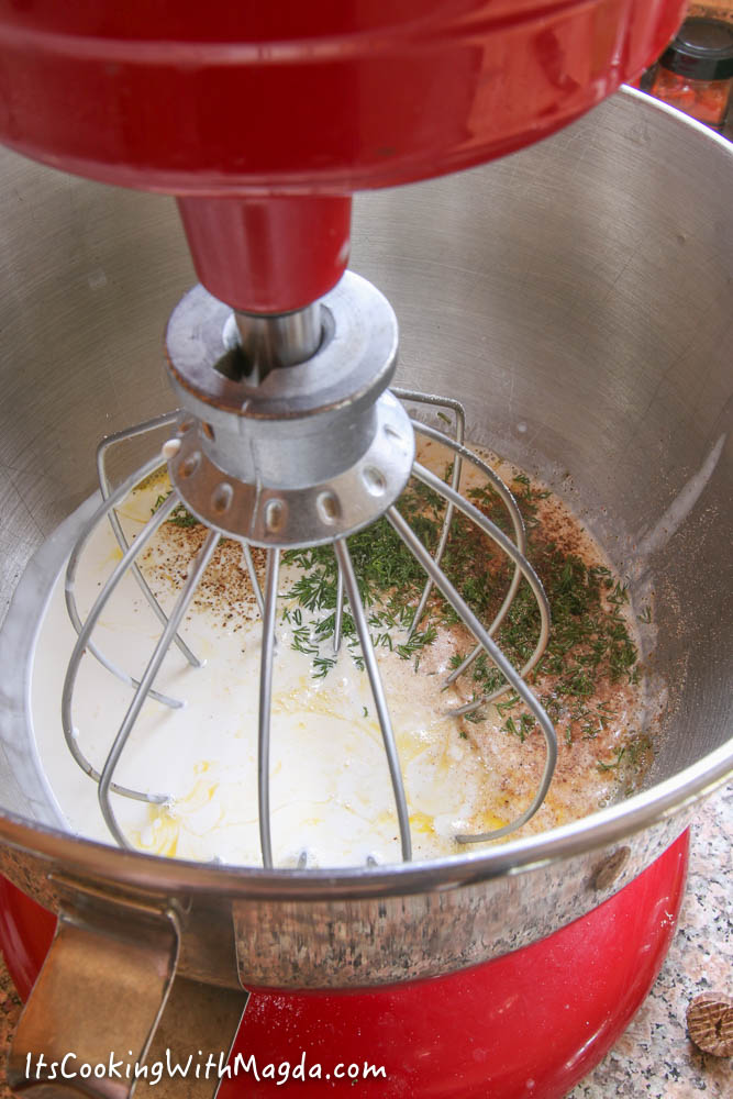 eggs, cream, milk and spices in a stand mixer bowl