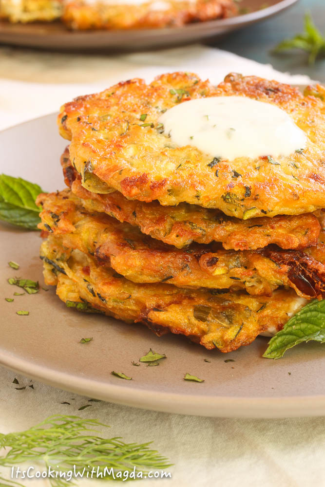 greek zucchini fritters with a dollop of herbed yogurt