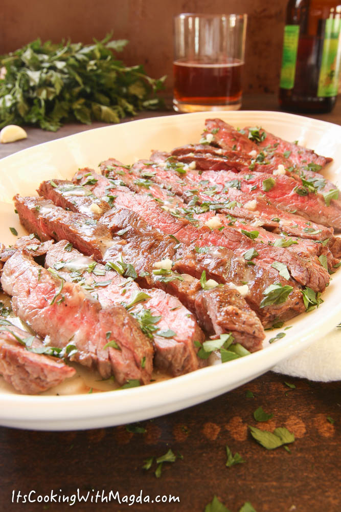 sliced skirt steak with butter, garlic and parsley