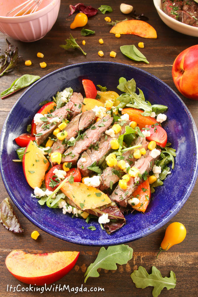 grilled skirt steak salad with nectarines, corn and goat cheese