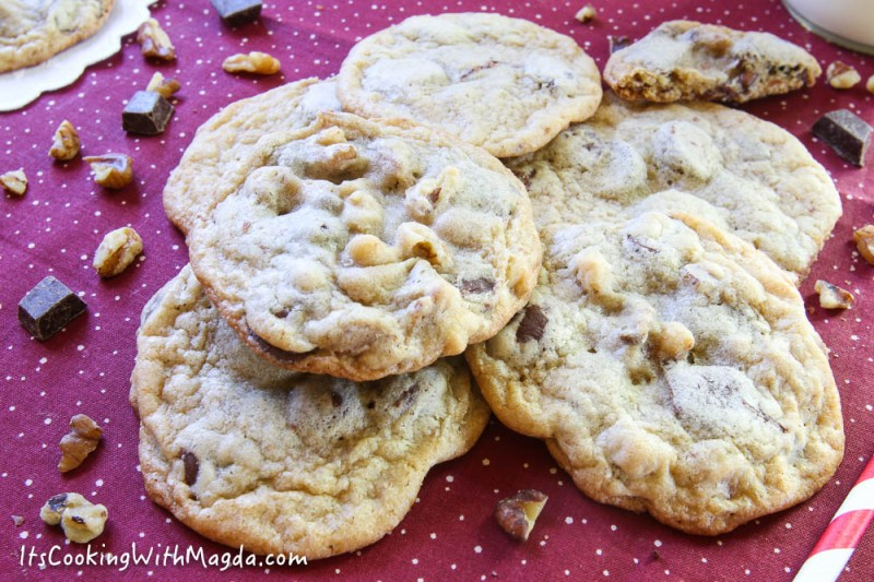 a stack of walnut and chocolate chip cookies