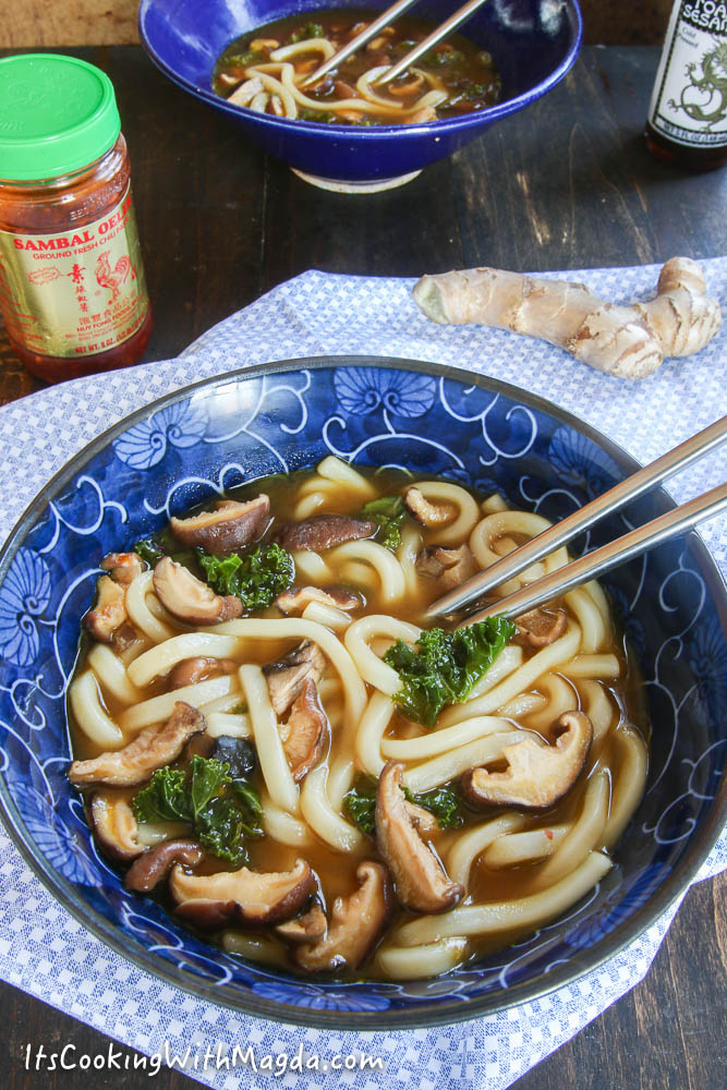 Udon noodles with mushrooms and greens