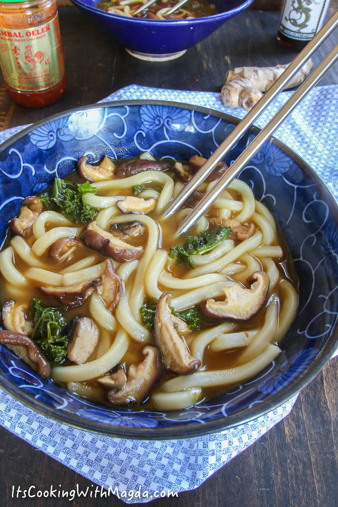 udon noodles with mushroom broth and greens